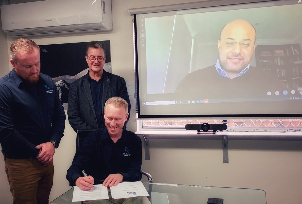 Chief Executives of Gilmour Space Technologies signing the contract with Space Machines Company